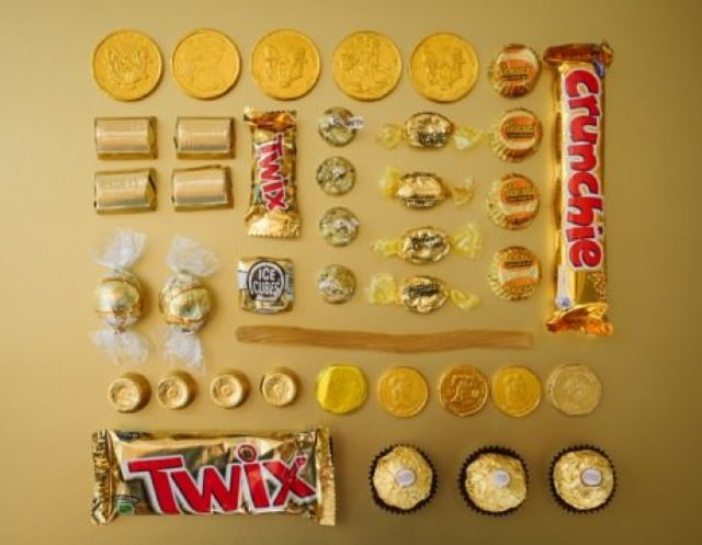 Gold candies for candy buffet Twix. Rolos. Reese's. werthers.