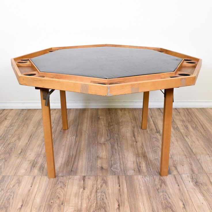This folding game table is featured in a solid wood with a raw light maple finish. This octagon poker table is in good condition with a folding base, tons of cupholders and a durable black table top. Perfect for playing cards on game nights! #americanmidcentury #tables #diningtable #sandiegovintage #vintagefurniture