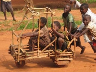 African Children Improvising, Playing, and having lots of Fun.