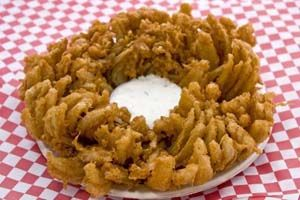 Gluten Free Blooming Onion Recipe: http://glutenfreerecipebox.com/gluten-free-bloomin-onion/