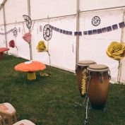 Alice in Wonderland Wedding - marquee/tent decoration with mushrooms and bongos!