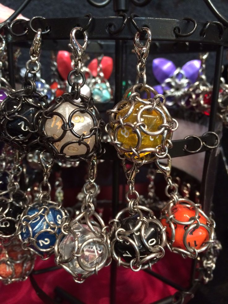Multi-sided dice in chain mail for zipper pulls, key chains, or just a cool thing. By Cortney Fellet, The Steel Web.