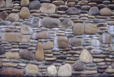 How to Install Decorative Rock Over a HardiePlank Exterior Wall