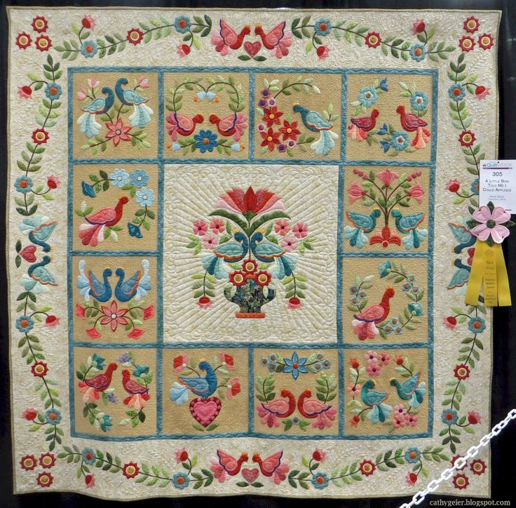 """""""A Little Bird Told Me I Could Applique"""" by Marie Blunk. Pattern: My Tweets, Block of the Month by Erin Russek. Quilted by Nancy Mancke. 2015 AQS quilt show- Paducah.  Photo by Cathy Geier."""