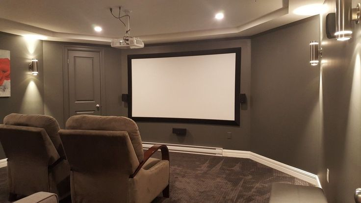 "The media room in our new home, designed by me. Walls are BM Iron Mountain, trim is BM White Dove. Carpet is Pensive Sky. AV gear is as follows: Denon AVR x1300W 7.2 surround sound receiver; Polk Audio speakers/subwoofer; Benq HT2150ST Home Cinema Series 1080p projector/ 100"" diy screen, velvet wrapped frame; Logitech smart hub universal remote; Lutron Wireless Smart Bridge; Lutron Wireless in-wall dimmer switches; Xbox One; Sony Blu-ray player; Western Digital media player"