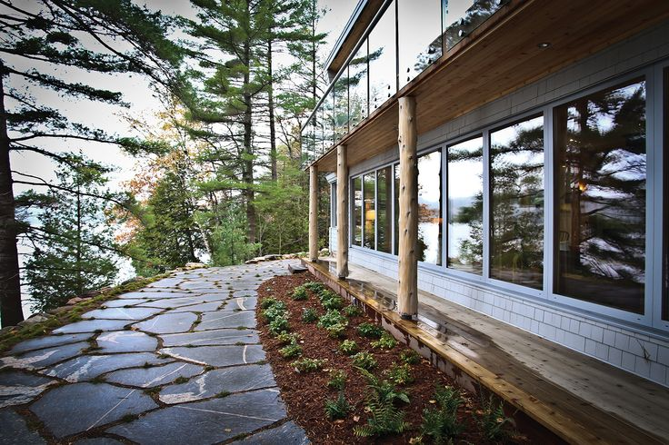 Large flagstone from the Muskoka Rock Company creates an attractive pathway around the cottage.