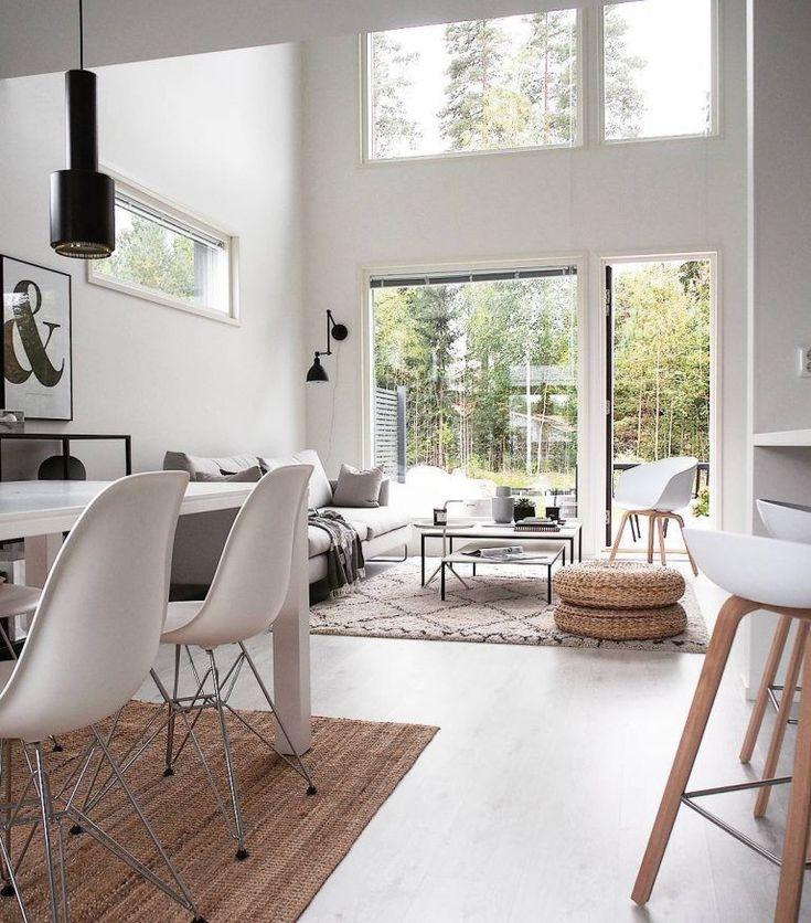 Modernia tyyliä ja kodikkaita luonnonläheisiä materiaaleja sisistuksessa.