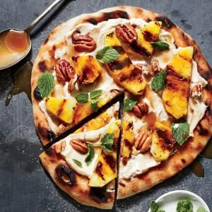 Grilled Pineapple Dessert Pizza | MyRecipes.com Pizza for dessert? Absolutely! This one features grilled pineapple, cream cheese, and pecans.