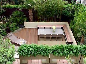 Dakterras Inrichting & Ontwerp: Strak Zen & Feng Shui Terras met Bamboe Planten, Houten Terras Vloer en Design Loungemeubelen LEES MEER..