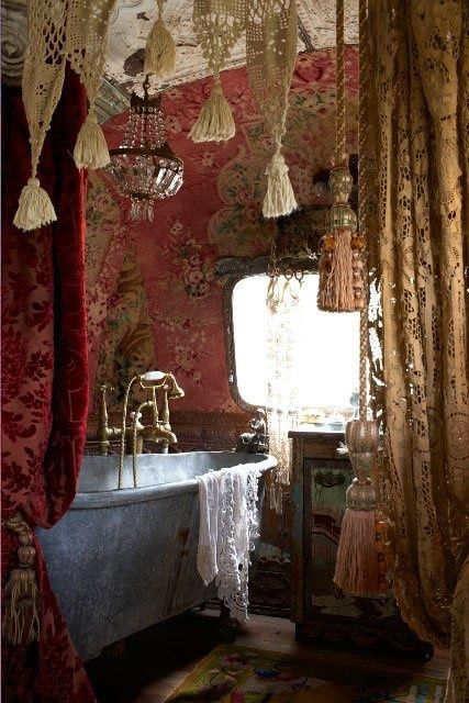 I love the crocheted ceiling hangings in this bohemian bathroom.