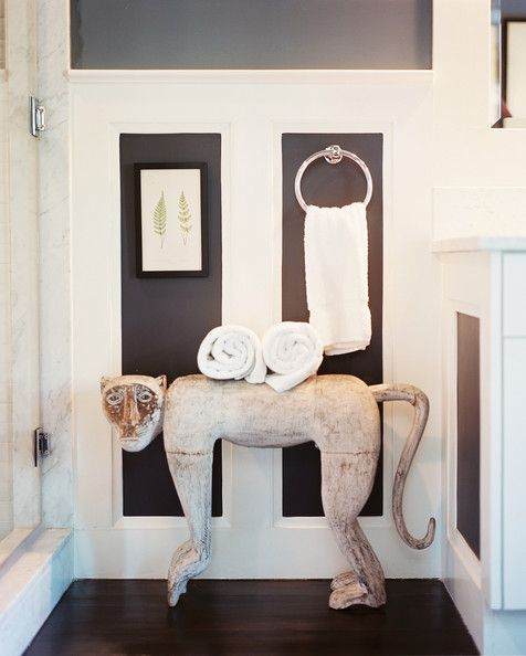 Bathroom Photo - A monkey statue used as a towel holder in a paneled bathroom--that's fun  AND functional