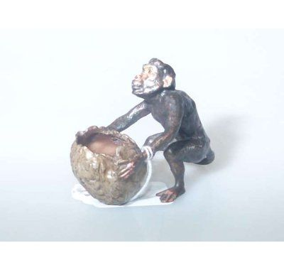 Cold painted bronze of a monkey. Lot 299. Estimate: £60-£80.