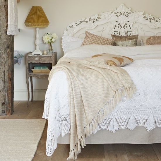 Opt for an ornate carved headboard: this bed is dressed with layers of lace, fringed throws and heaps of crisp broderie Anglais-edged pillowcases to create a gorgeous French-style bedroom. An ornate carved headboard adds detail to the neutral-toned walls.  | How to create a French-style home | French decorating ideas | Country decorating | PHOTO GALLERY | Country Homes & Interiors | Housetohome