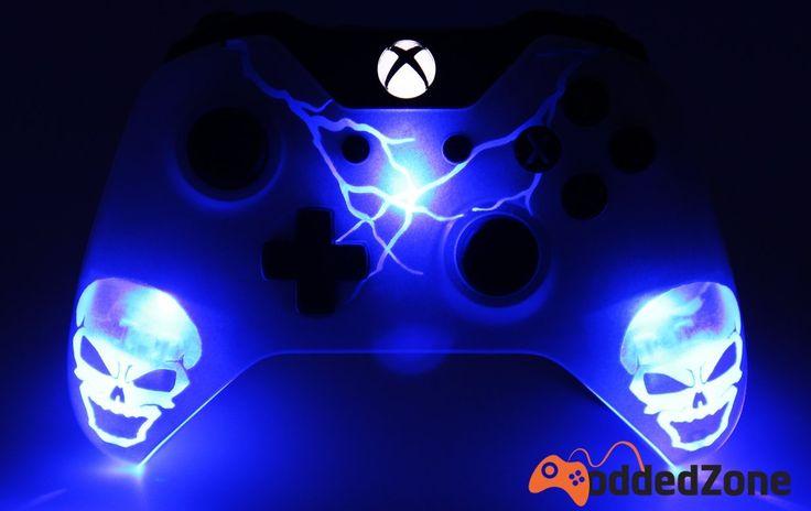 Modded Xbox one controller with a custom illuminated skull paint job. The…