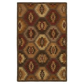 Handcrafted wool rug with a Southwestern-style motif.  Product: RugConstruction Material: 100% WoolColor: BrownFeatures: Hand-tuftedNote: Please be aware that actual colors may vary from those shown on your screen. Accent rugs may also not show the entire pattern that the corresponding area rugs have.Cleaning and Care: Vacuum and spot clean as needed.  Do not use a beater bar.