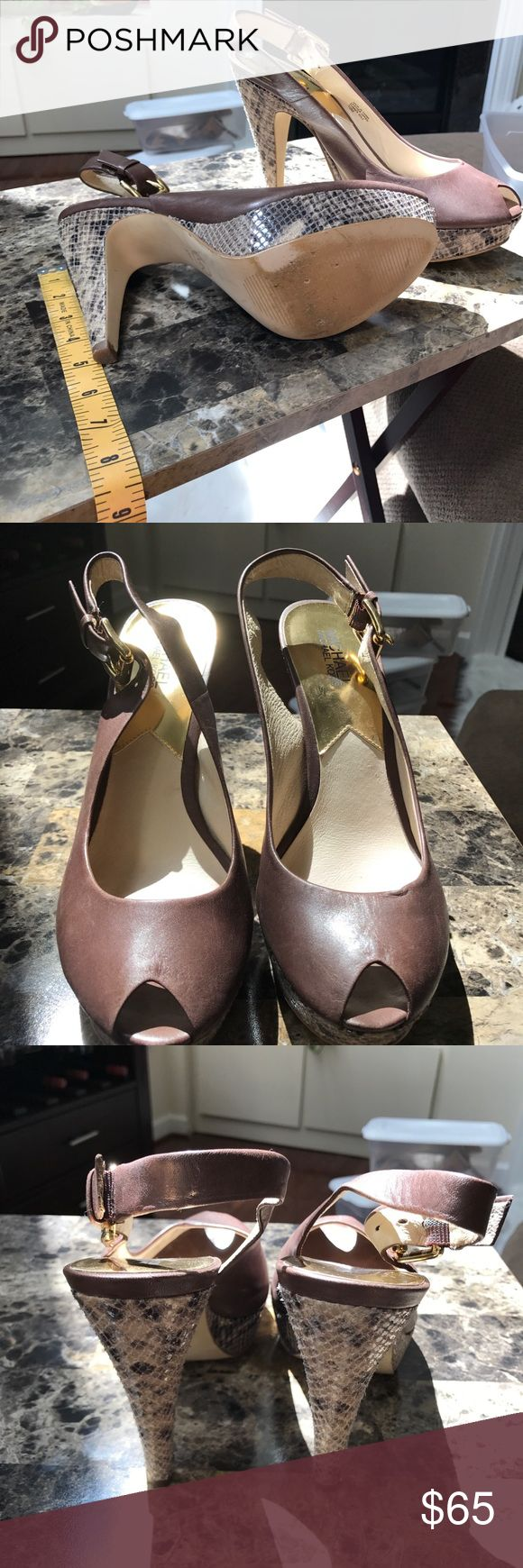 "Michael Kors peeptoe platform brown snakeskin heel 5"" heels brown leather peep toe with back ankle strap with gold colored buckle. Heel and platform is snakeskin. Shoe is used but in good condition. KORS Michael Kors Shoes Heels"