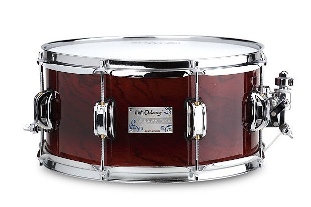 We Are Amp'd GuitarsAn Authorized Odery DealerThis is the Odery Nyatoh Wood Red River Explosion Finish snare drum only...amazing sound and quality!!SNARE 13×6.5 – NYATOH WOOD100% Nyatoh (Philippines) shellFinish: Red RiverPower hoop 2,3mmCode: S.EYE.1365-NY.RRP