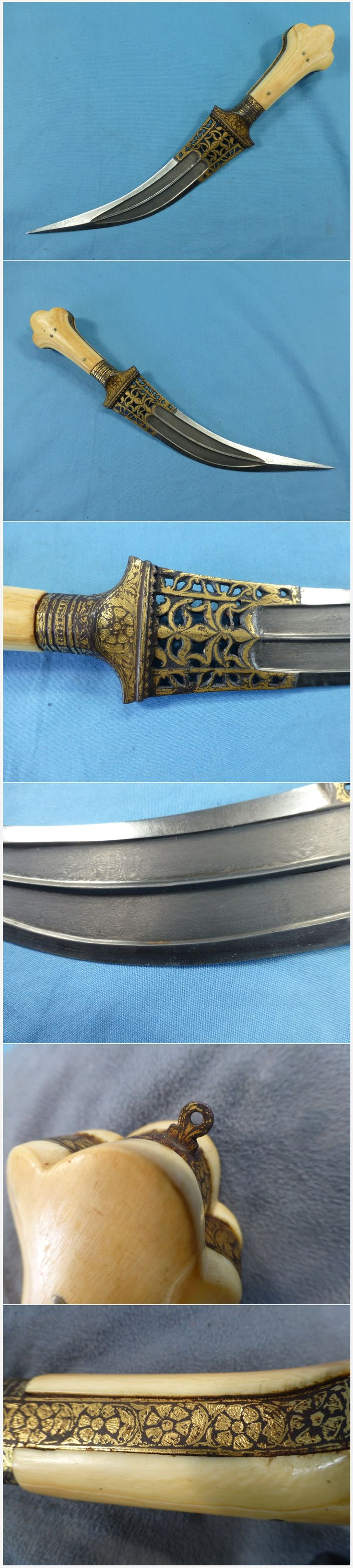 Indian (North) tiger tooth jambiya dagger, curved wootz (damascus, watered) steel blade pierced at its upper part with reinforced edges and slightly thickened tip, full tang with big bolsters, wide grip strap and very typical three lobed pommel, gold koftgari work on the ricasso bolsters and grip strap. The grips are ivory. Total length13 inches, blade 8 inches.