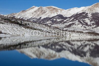 Campotosto lake at winter season, Abruzzo - Italy. #Winter #Snow #Tourism #Travel #Apennines #Mountains #Reflects #Lake #Campotosto #Tourism