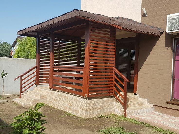 Pergola eleganta din lemn, pentru terasa.