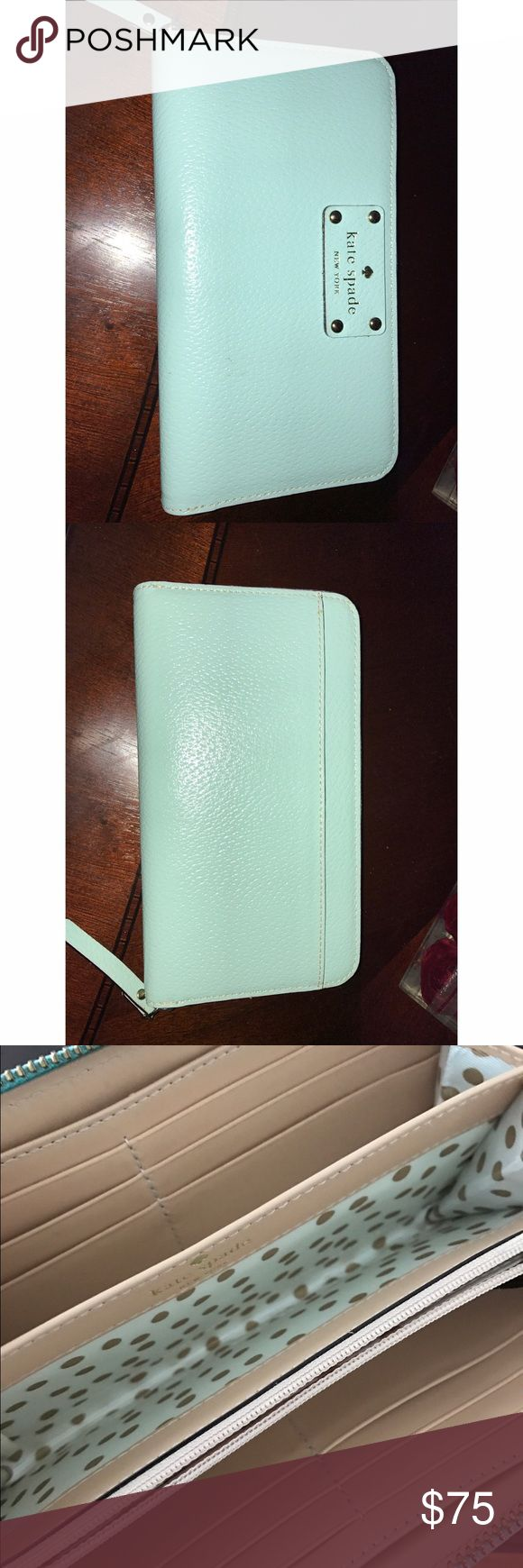 """Tiffany Blue Kate Spade ♠️ Zip-Around Wallet A beautiful boar skin leather wallet in robin egg blue with many great features. 12 credit card slots, a center zip pocket, 2 full length bill slip pockets, 2 large expandable pockets, can easily hold a cell phone. Measures: 8"""" (W) X 4""""(H) X 2""""(D) kate spade Bags Wallets"""