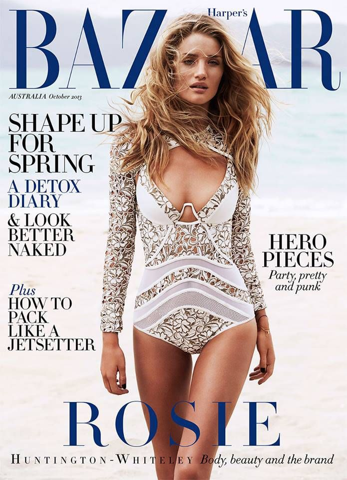 Rosie Huntington-Whiteley wearing a long sleeve bathing suit on the cover of Harpers Bazaar---> http://fashionilluminati.com/swimwear-trends-for-summer-2014/