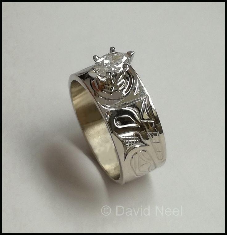 A Wolf Ring in white gold with a Marquis cut diamond.  #northwestCoastIndianArt #firstNationsArt #nativeArt #nativeAmericanArt #canadianAboriginalArt www.davidneel.com