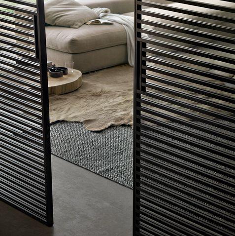 Stripe Rimadesio  www.spaziomateriae.com   Rimadesio Stripe Door in brown aluminum  struttura alluminio brown e vetro trasparente grigio