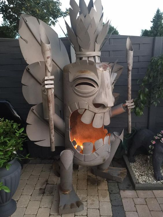 Amazing fabricated Tiki God backyard fire place.                              …