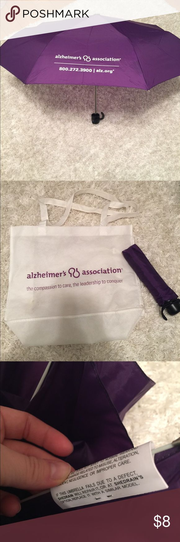 Alzheimer's umbrella 🌂 and tote Umbrella has never been used and has a warranty on it. The tote is also included and has a tiny stain (as seen in photo) that I'm sure will come out with cleaning. :) alzheimers assoc. Accessories Umbrellas