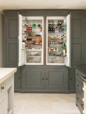 A free standing statement fridge freezer with pantry cupboard