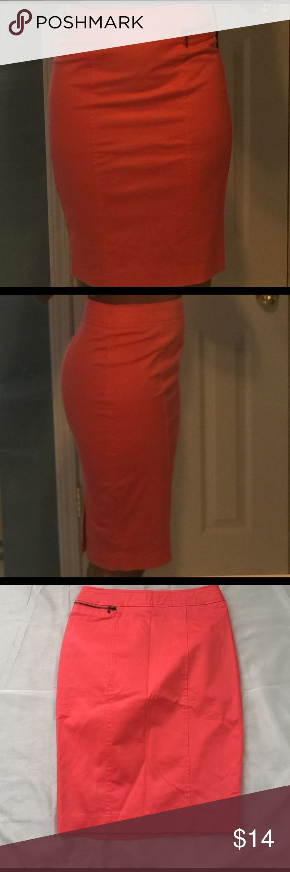 Beautiful coral Pencil skirt Coral Pencil skirt with two splits in the back hidden upper zipper and side front zipper pocket. Fits like a glove. Beautiful spring coral color. Hits me at the knee I'm 5'5. 22.5 inches long messimo Skirts Pencil