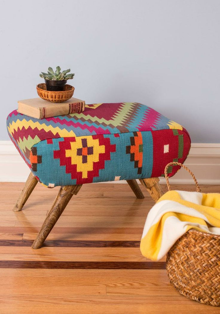 Livin' Lodge Ottoman | After affixing the wooden legs to the plush top of this footstool, you pop on some tunes, pour some mulled wine, curl up under a deer-print throw blanket, and invite a few pals over to hang in the woodsy atmosphere you've carefully cultivated.