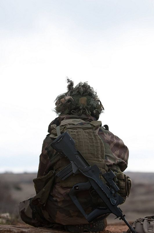 French Army soldiers with 2nd Combat Company, 8th Marine Infantry Parachute Regiment (8e RPIMa), conducting a live fire range training exercise. Camp du Larzac, La Cavalerie dans l'Aveyron. Feb 19, 2016