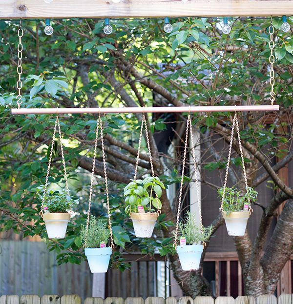 Colorful updates to a flower filled outdoor living room for Colorful hanging planters