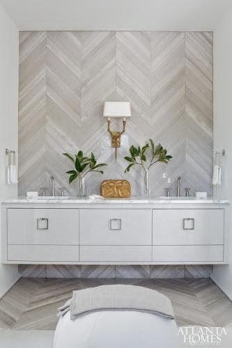 Chevron patterned tile wall via COCOCOZY: 7 BRIGHT BATHROOM DESIGN IDEAS