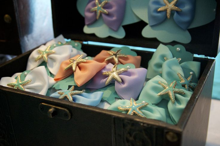 "Starfish hairbows for all the little mermaids at this ""Under the Sea"" party - what a great touch! (See more party ideas at projectnursery.com)"