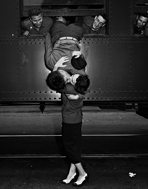 Daily Portrait: June 22, 2013  Photo by Unknown  From a series of vintage photos  Kiss Me On the Tracks
