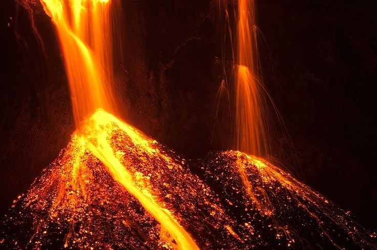 Lava Falls Stream Of Glowing Lava Coming From An Active Volcanic - Incredible neon blue lava flames erupt volcano