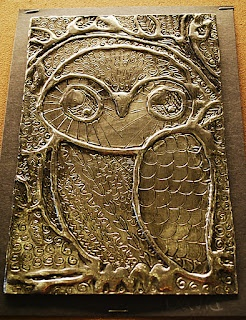 3D metallic art: draw image on cardboard with glue, press foil over it, etch detail with pencil, highlight with shoe polish.  Make It... a Wonderful Life: Owls, Foil, Glue, and Shoe Polish