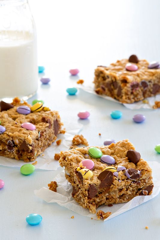 Monster cookie bars are loaded with peanut butter, oats and M&M's and perfect for just about any celebration.