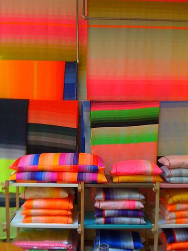 These simple yet effective gradient textile pieces have a bold look. Creative use of mixing colours and stripes, some gradating to the next colour, others simply creating a flash of contrasting colour.