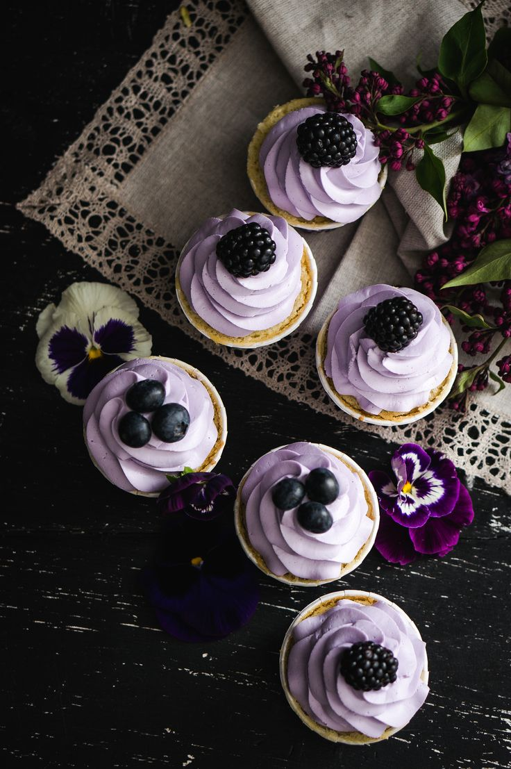 Lavender cupcakes with blueberries and blackberries and pansies