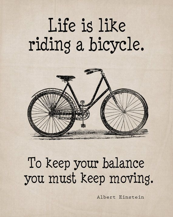 This is a printable image of a vintage bicycle with the word art: Life is like riding a bicycle. To keep your balance, you must keep moving.