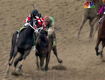 Afleet Alex nearly falls at the top of the stretch after Scrappy T drifts into his path. Afleet Alex miraculously recovered and went on to win the 2005 Preakness by 5 lengths.