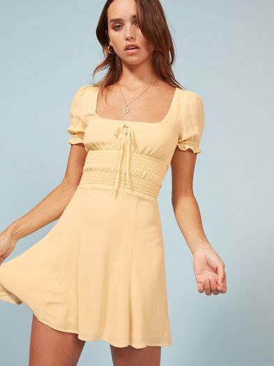 Well aren't you precious. This is a mini length dress with a smocked waist and a square neckline.