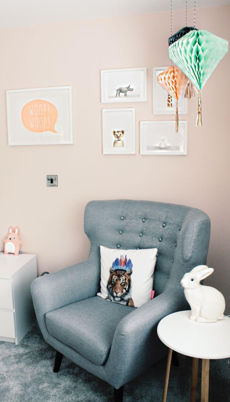 Peach room with animal details and pom poms!