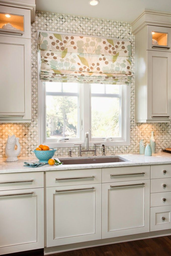 Lovely kitchen in golds and teal accents on off-white background