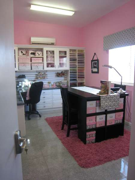 Scrapbooking room.  I'd love to have tall storage along the wall like that, with wraparound counter tops and a large center island for laying out/cutting fabric