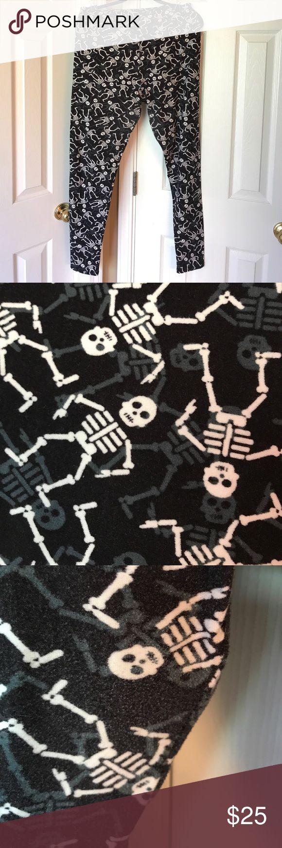 TC Halloween leggings TC Halloween LuLaRoe leggings. Black base with white and dark grey skeletons. A little worn on inner thigh. Pictured. Worn/washed once. LuLaRoe Pants Leggings